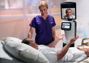 遠隔地にいる医師が、RP-VITAを使って病室を回診することができる